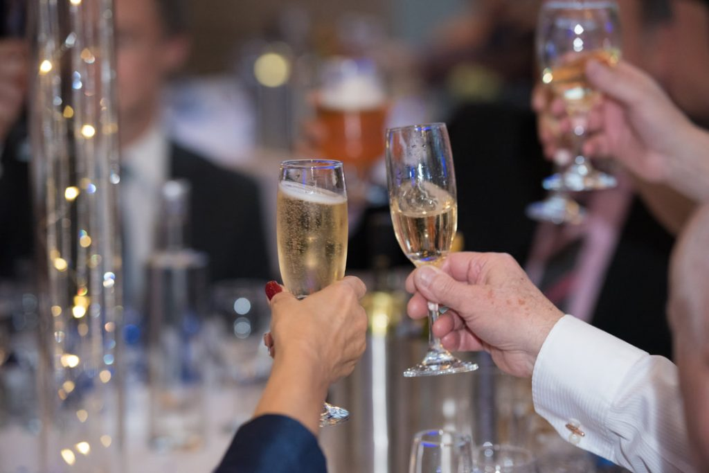 Wedding guests toast the bride and groom