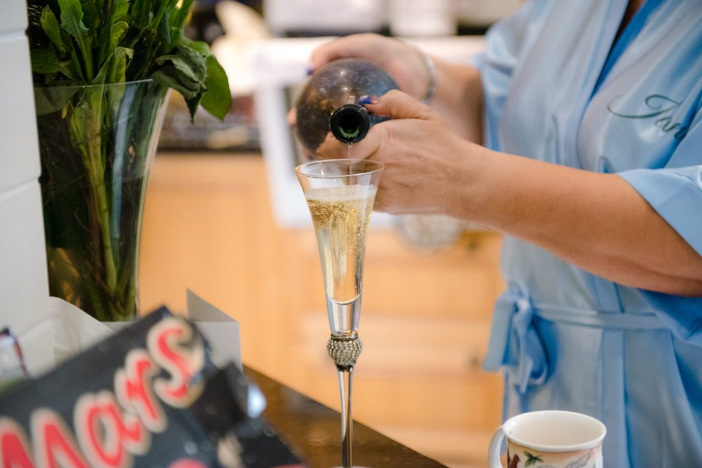 A glass of champagne is poured out for the celebrations