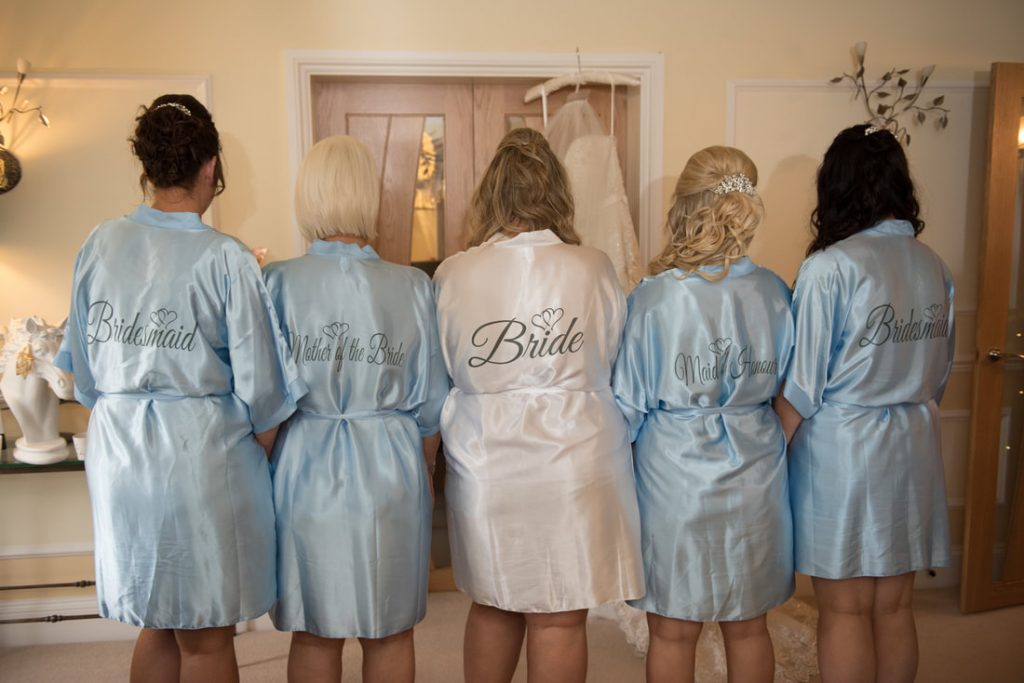 The back of the dressing gowns of the bridal party