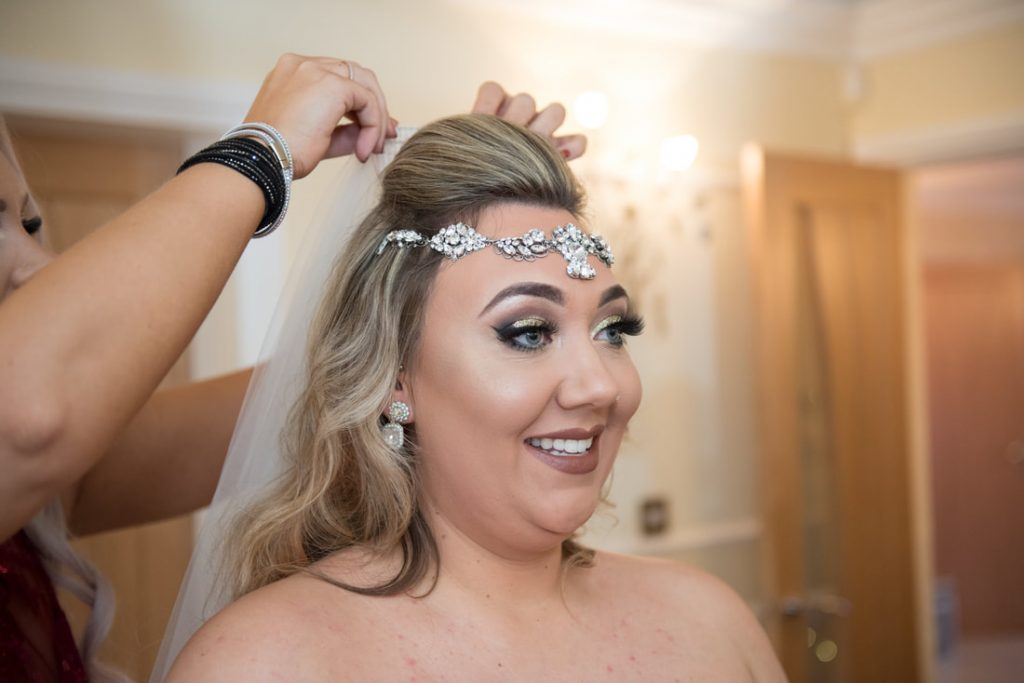 The bride wears a stunning headpiece
