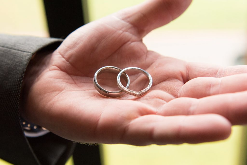 The rings held safely by the best man