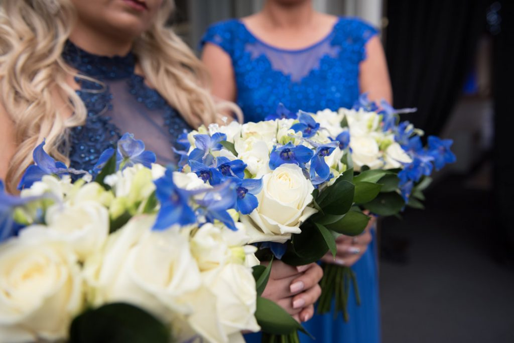 The bridal bouquet of flowers in blue and ivory