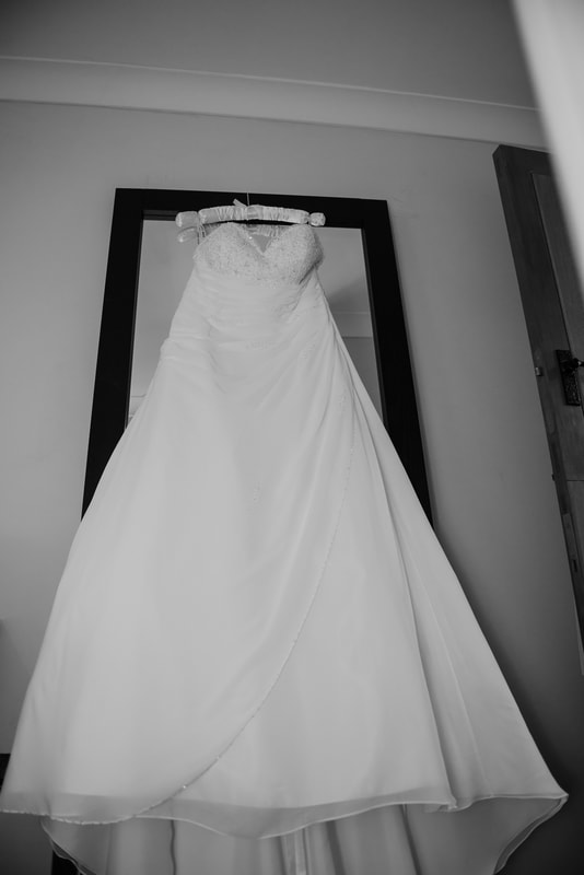 Wedding dress hanging from a mirror