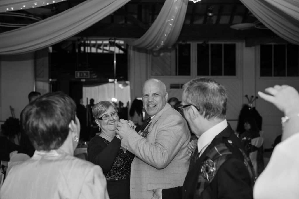 Guests dancing together at ridings barn