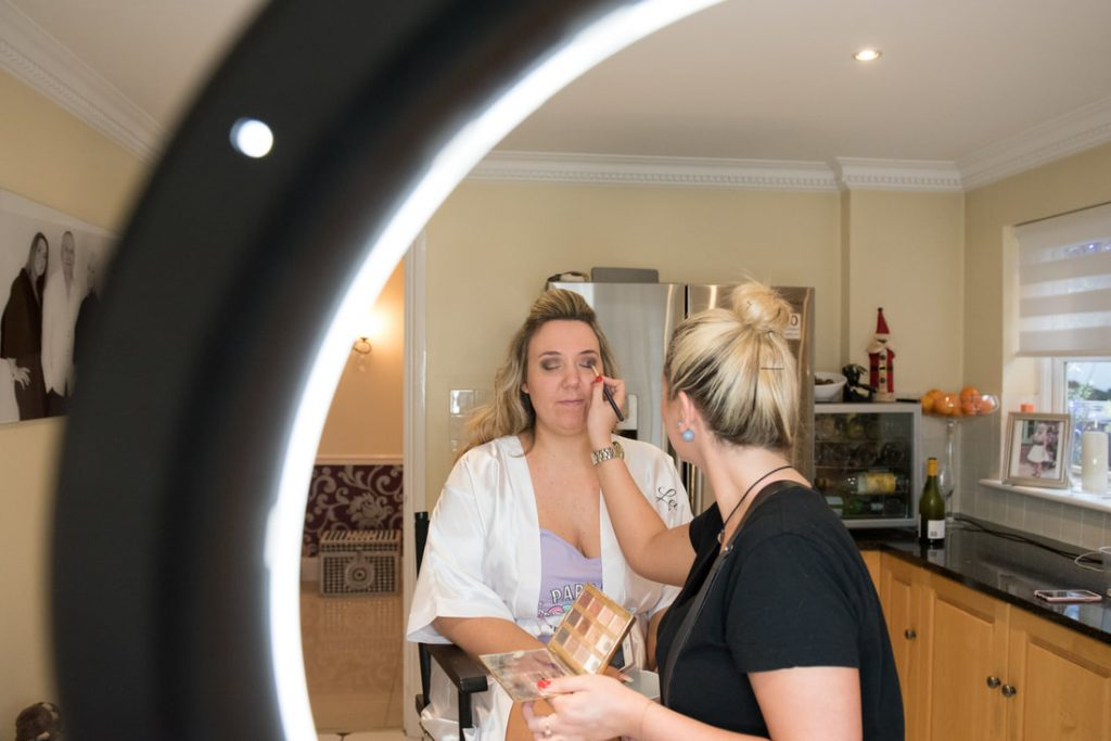 The bride having makup applied for her Essendon Country Club Wedding
