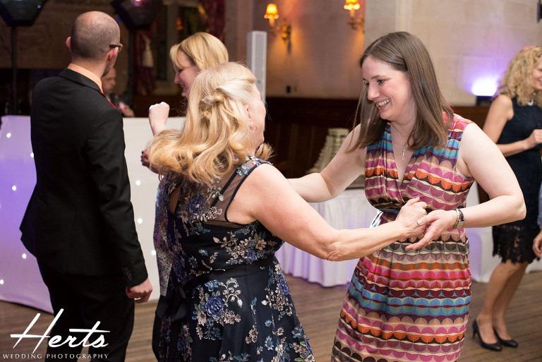 Guests dance together at fanhams hall hotel