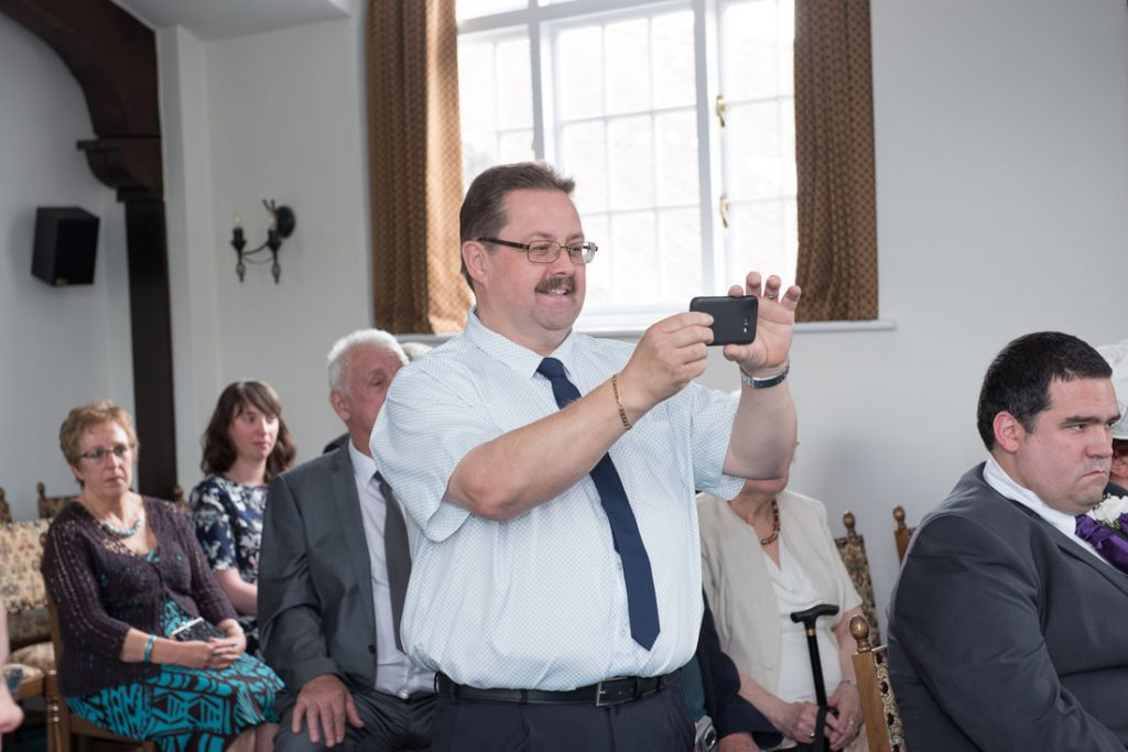 A guest takes a photo on his mobile phone