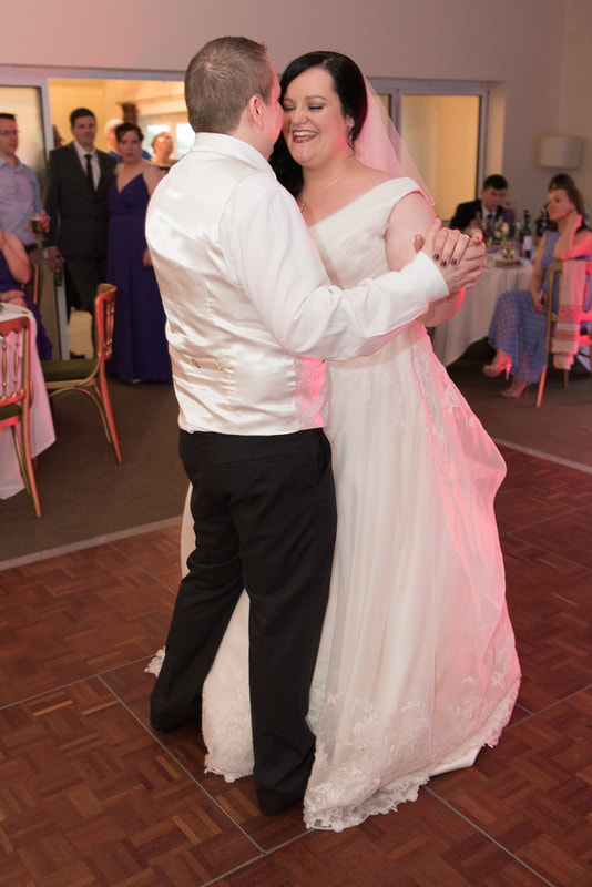 The bride and groom dance together