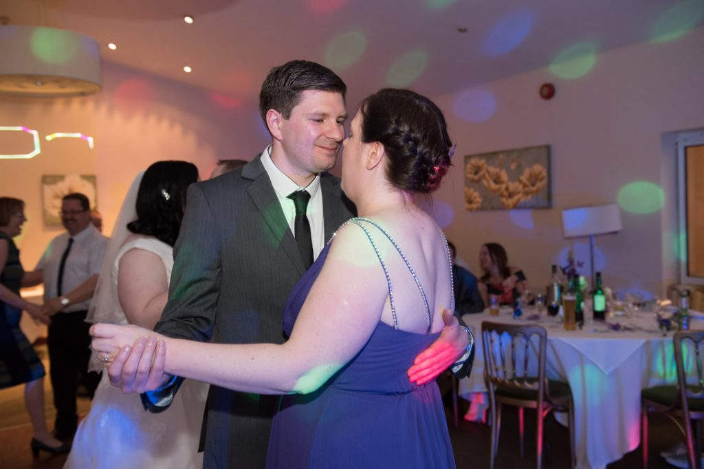 Wedding guests dance together