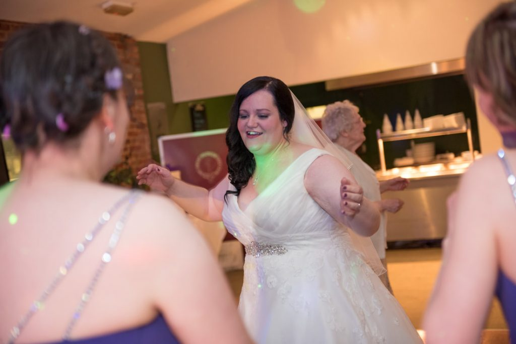 The bride dances with her friends