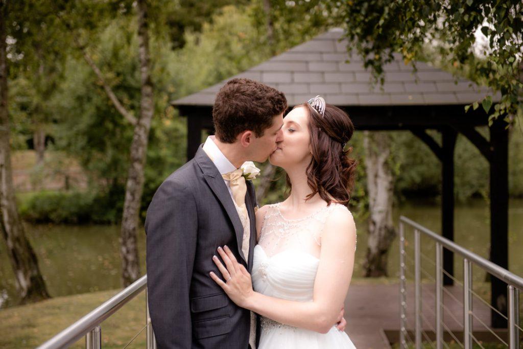 A kiss at Great Hallingbury Manor Wedding