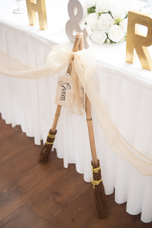 2 Broomsticks at the front of the top table