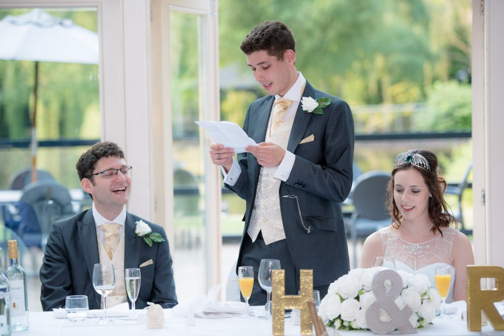 The groom reads out his wedding speech