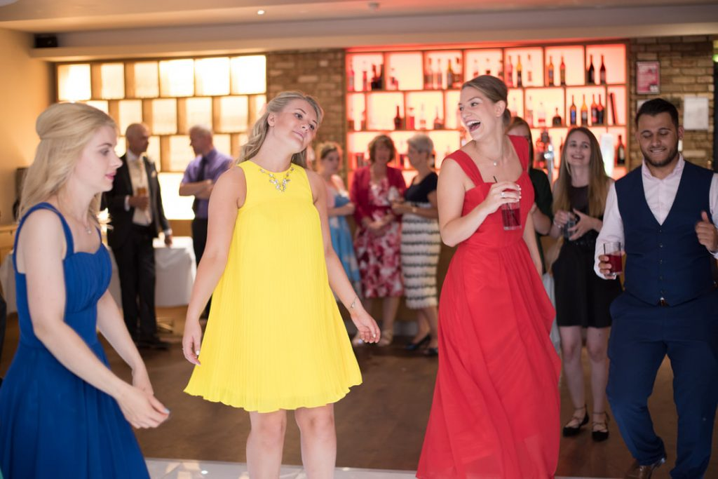 Wedding guests dance together at Great Hallingbury Manor