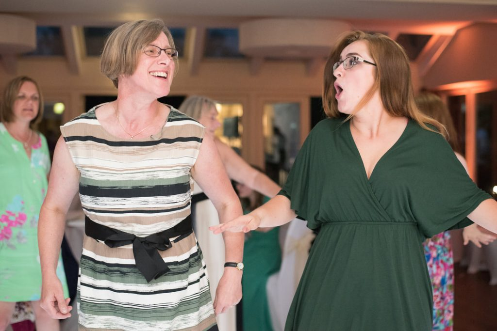 Mother and daughter dance together