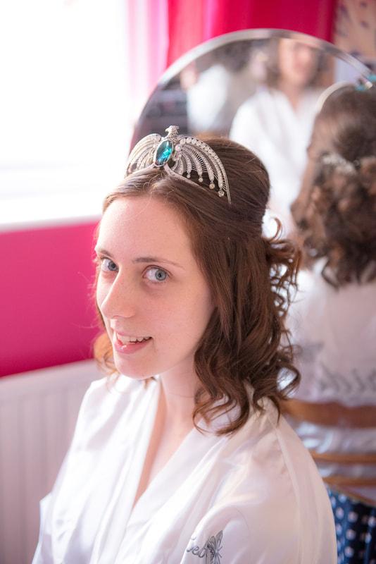 The bride wears a harry potter head piece