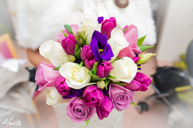 The brides colourful bouquet of flowers