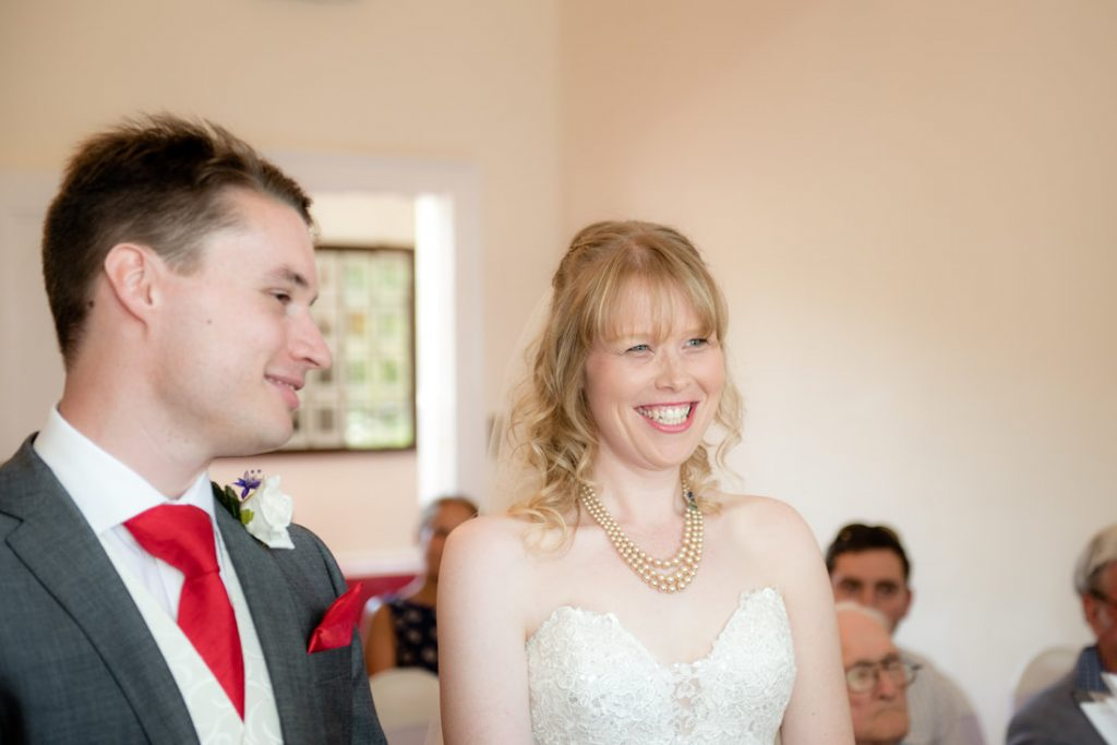 The smiling bride and groom