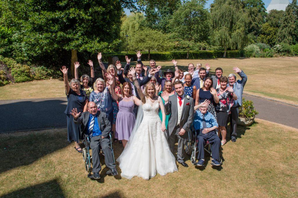 The guests waving at the camera