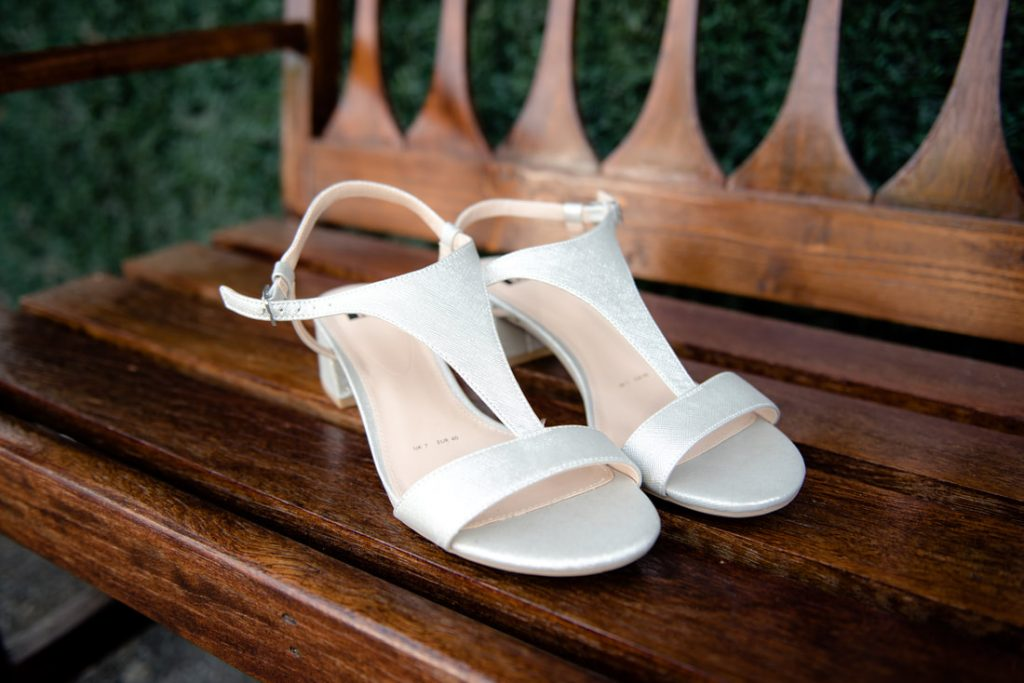 Wedding shoes on a wooden bench