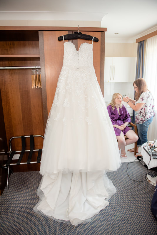 Wedding dress hanging on a hotel wardrobe