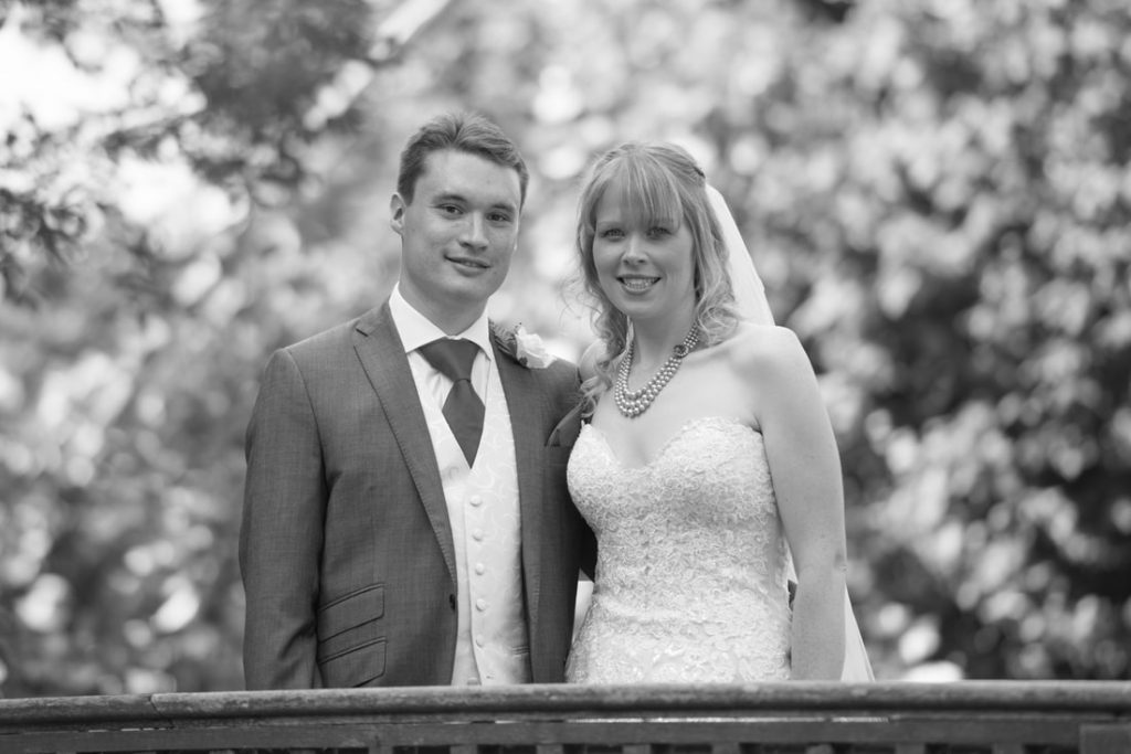 The bride and groom in black and white