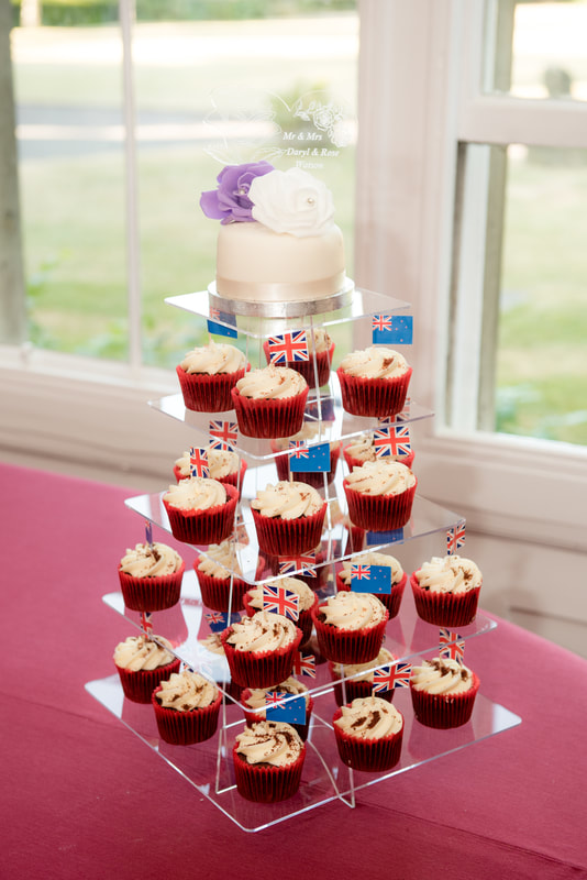 The wedding cake and cupcakes