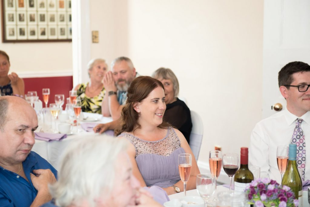 Guests at their wedding tables