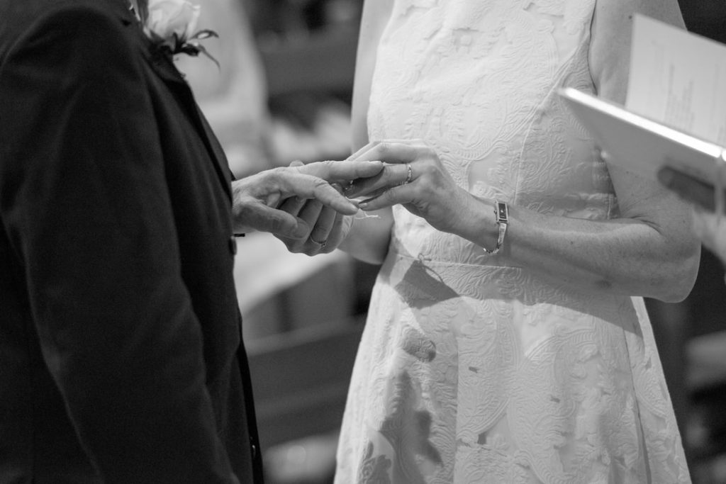 The bride and groom exchanging wedding rings