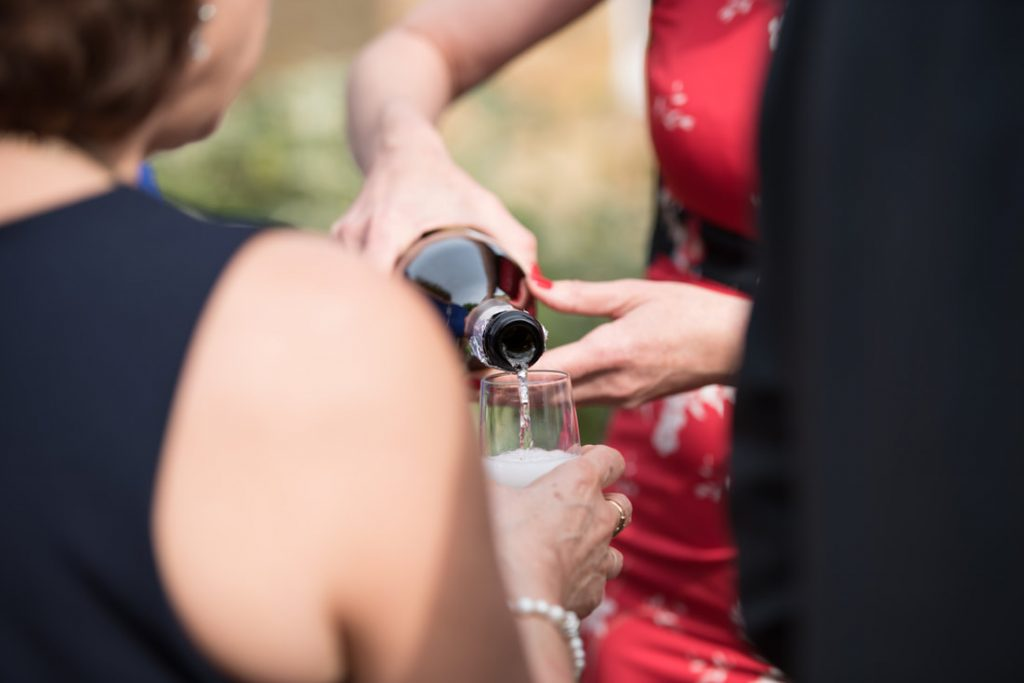 Champagne being poured at the wedding