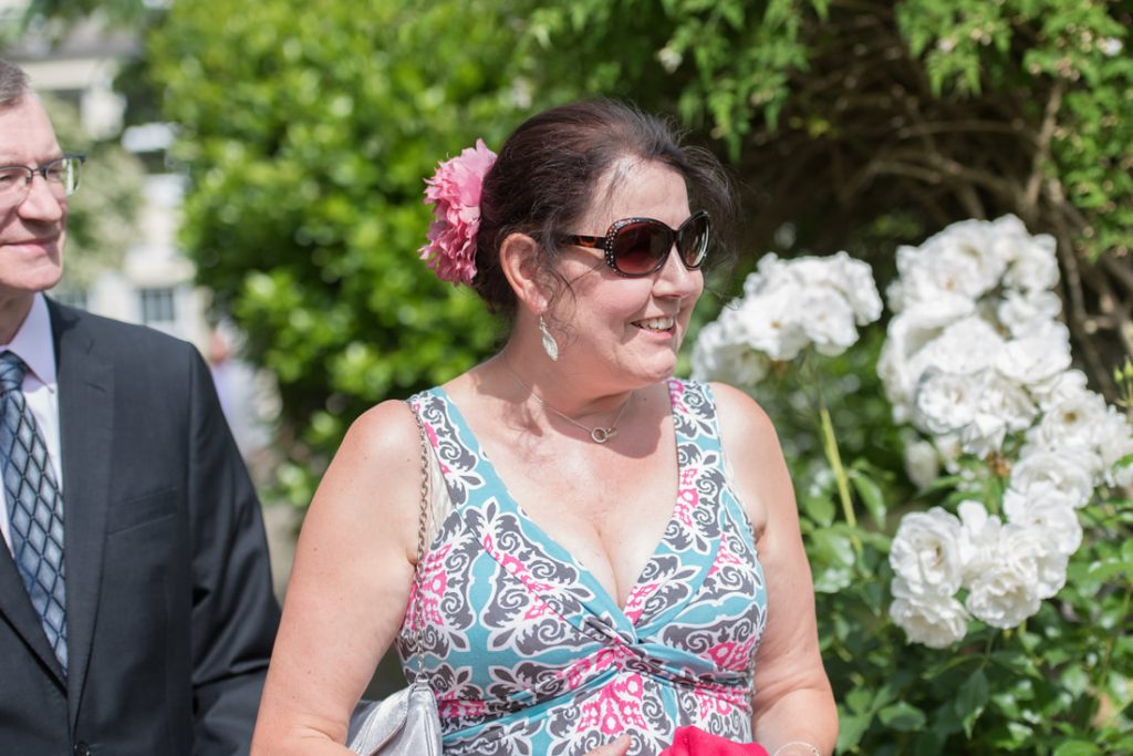 Wedding guests enjoying the sunshine