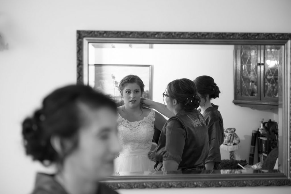 The bride looking at herself in the mirror