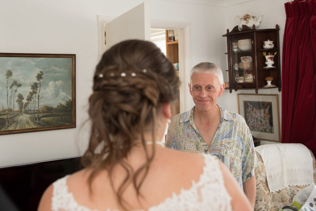 Dads first look of his daughter in her wedding dress