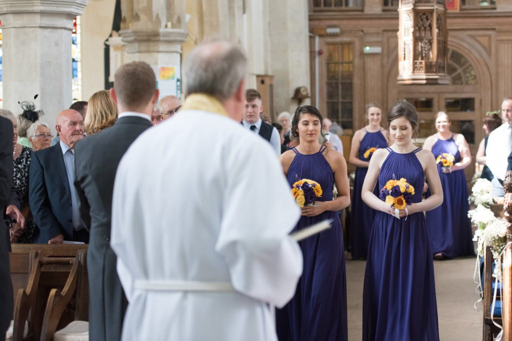 The bridal party walking up the church aisle