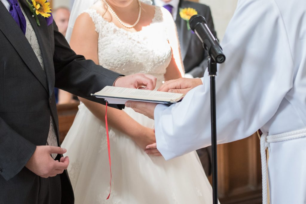 Wedding rings being blessed on the bible