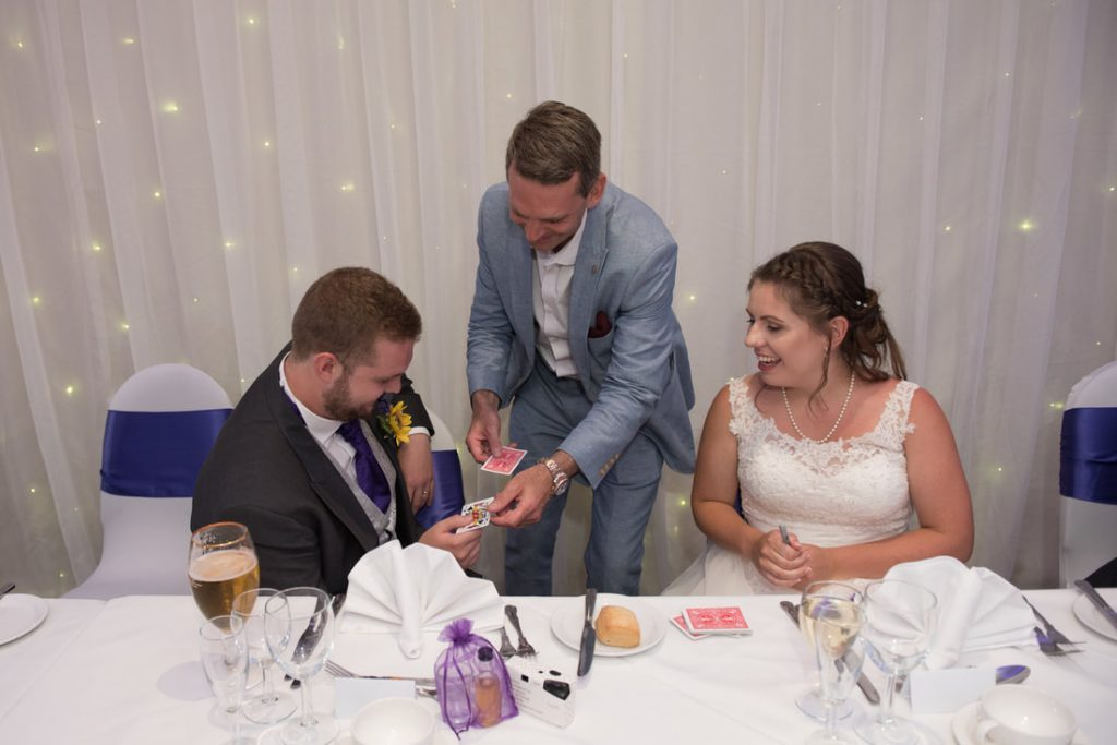 The bride and groom with Lee Smith Magician