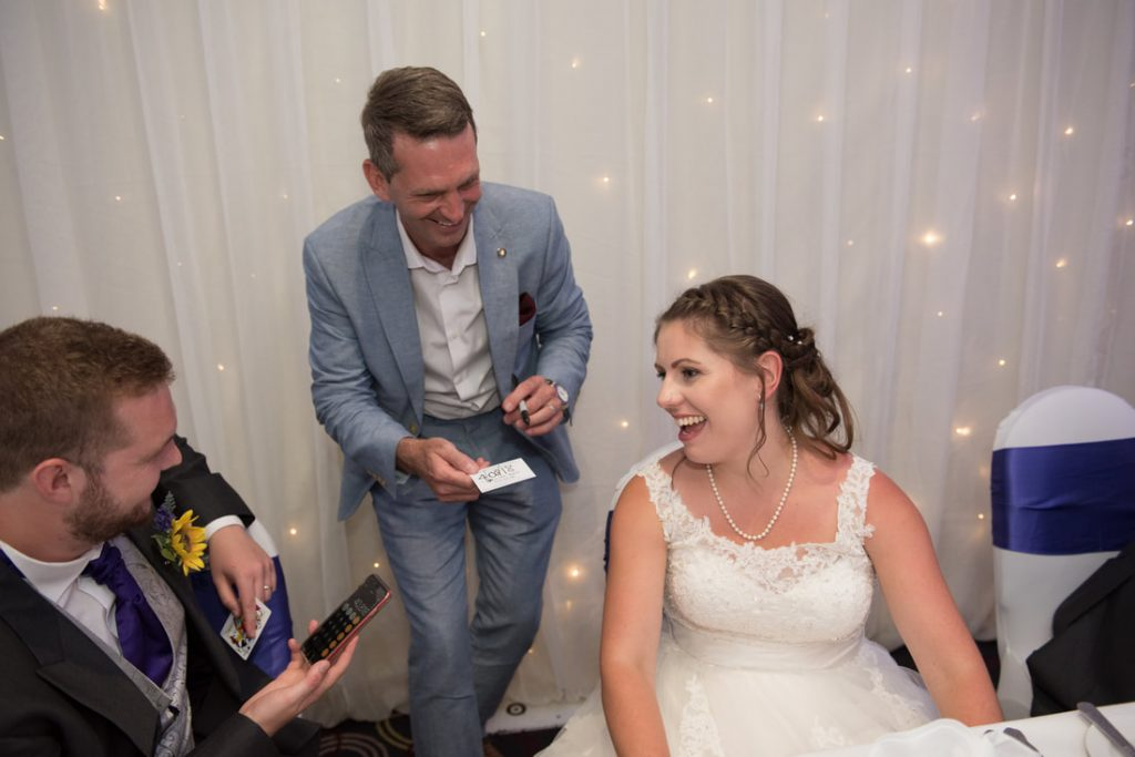 The bride enjoying the magic with Lee Smith