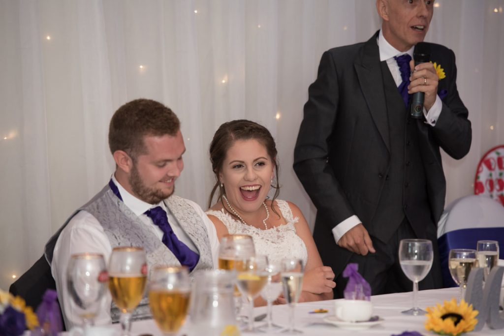 The bride laughing at her dads speech