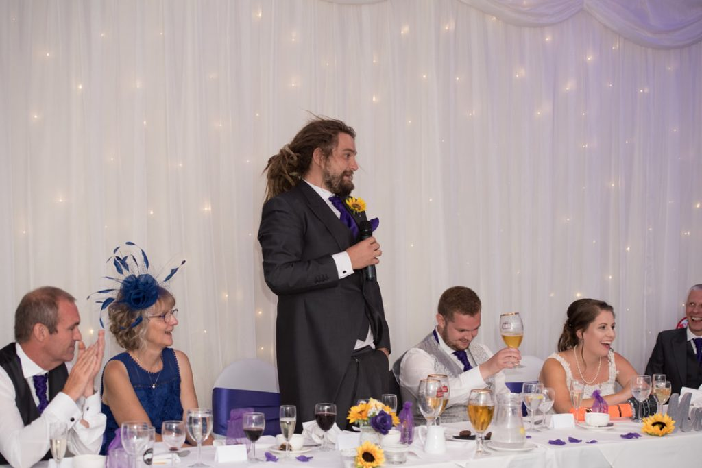 The best man giving his speech