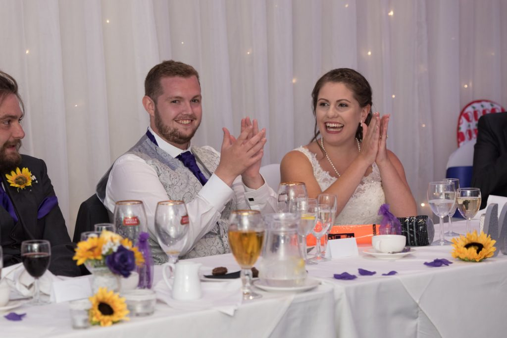 The bride and groom clapping the song