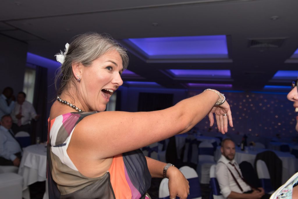 A wedding guest having fun on the dancefloor