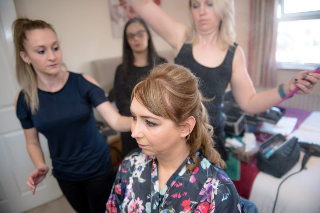 Hairspray being applied to bride