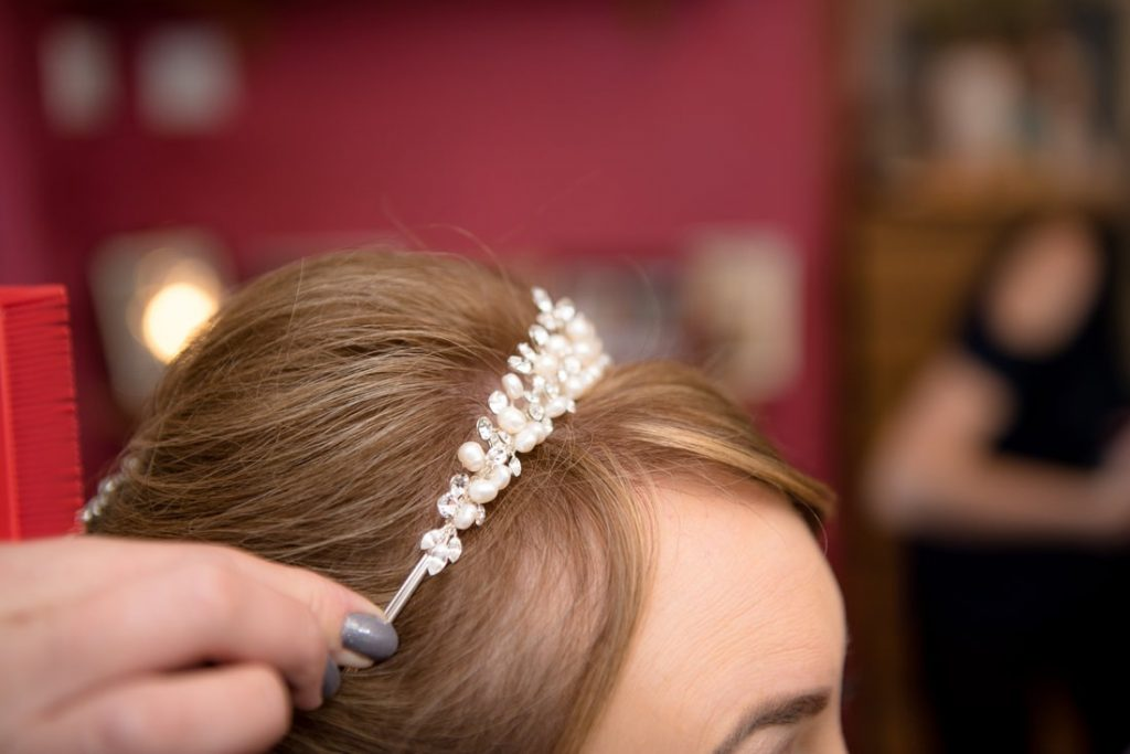 Bridal hairpiece being positioned in place