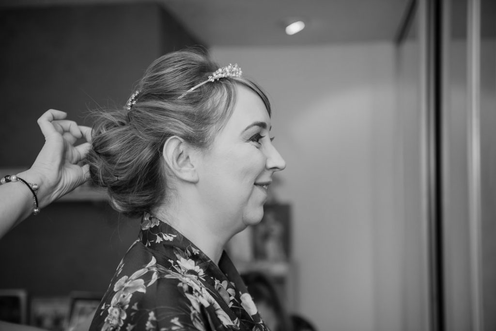 The bride smiling in the mirror