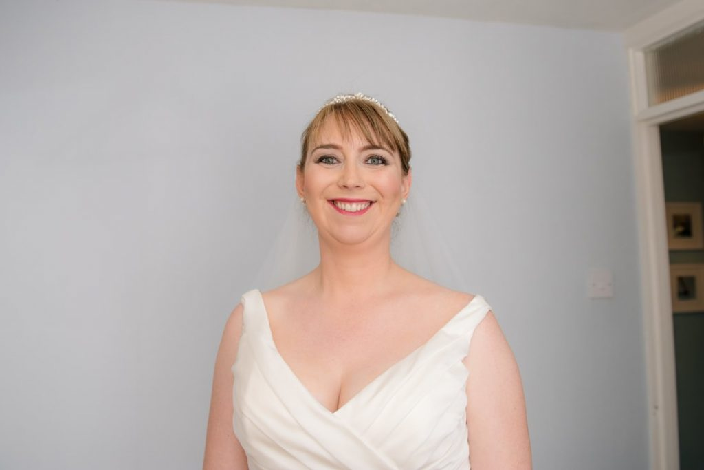 The beautiful bride smiling