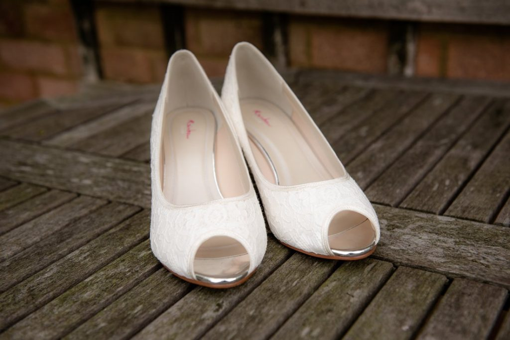 Bride rainbow shoes on a table