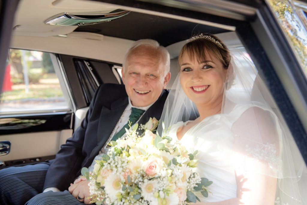 The bride and her dad arriving at church