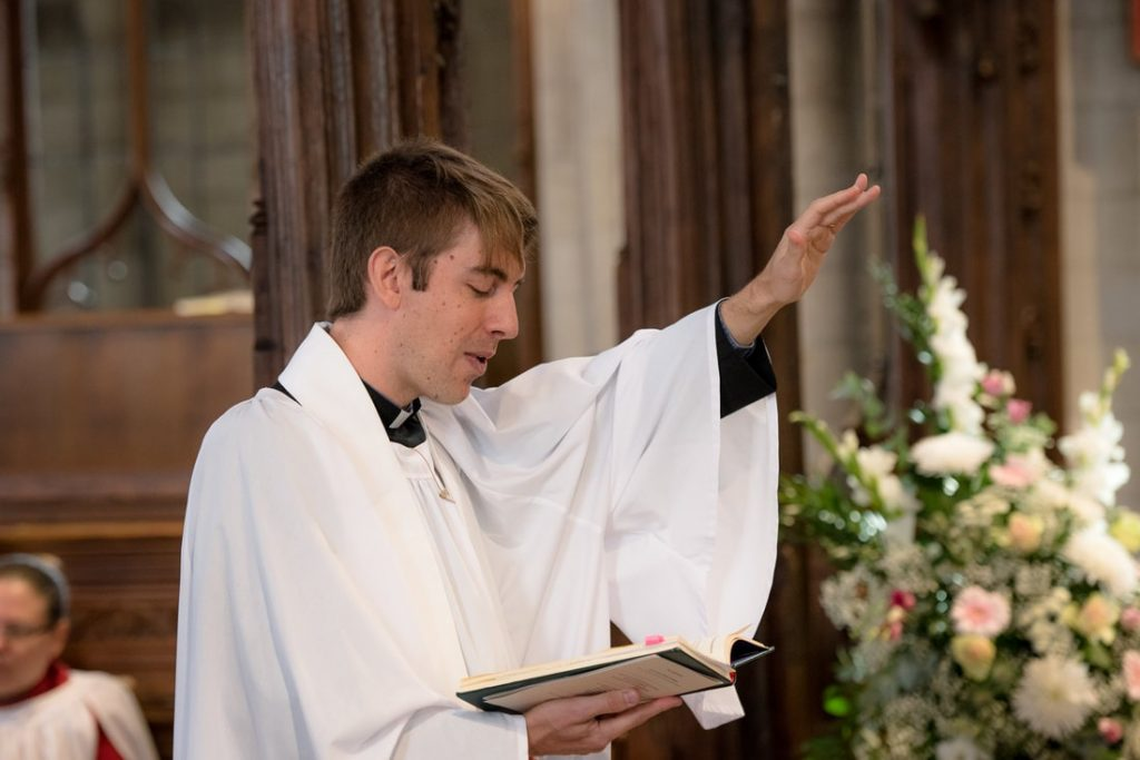 The priest giving his blessing