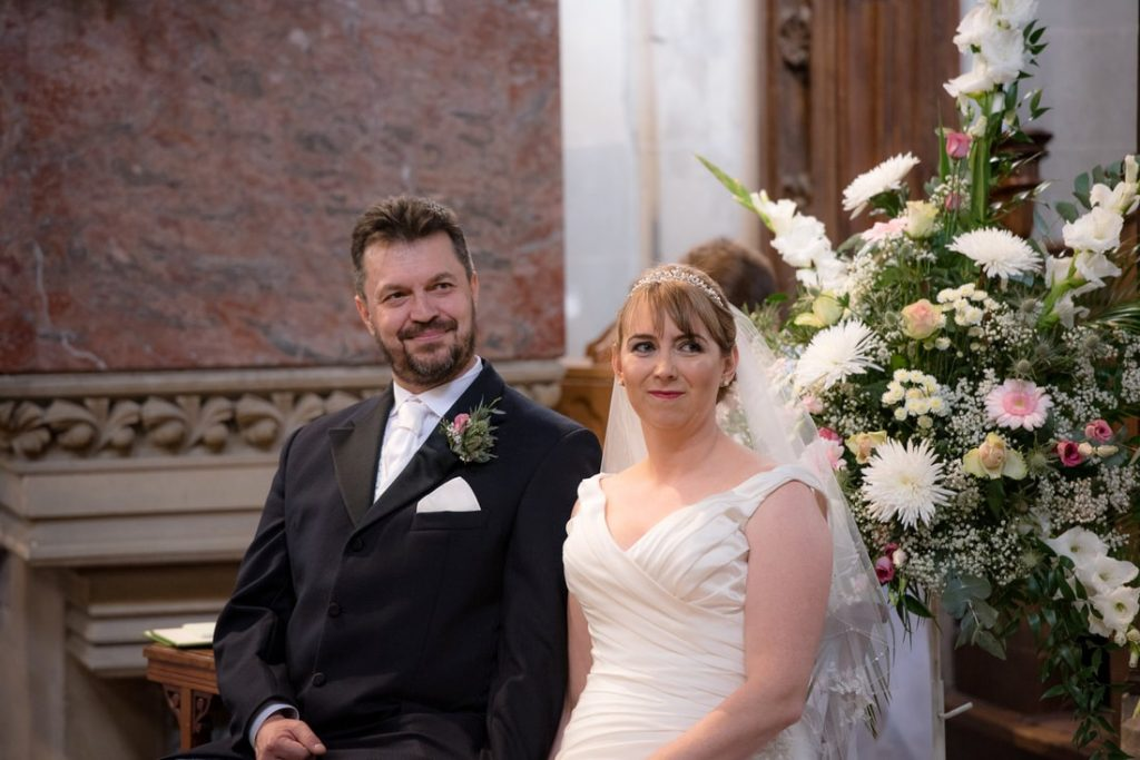 The bride and groom sitting in church