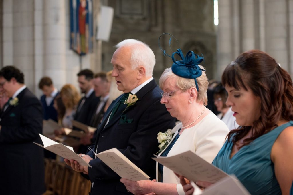 Wedding guests singing hymns